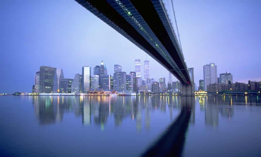 View of Manhattan skyline from below New York's Brooklyn Bridge