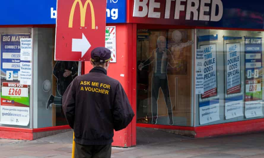 Worker holding a McDonald's advertising banner