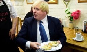 The foreign secretary tucks into a teacake.