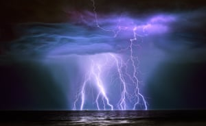 """Oil Tanker hit by lightning, Australia, by Graham Newman. """"The Guanabra is a 240m-long supertanker and was loaded with crude oil from the Australian north west offshore oil fields at Barrow Island. The ship was approximately 5.3km from the camera when I took the shot at 3.10am. Shortly after taking the shot, the lightning cell closed on my position on the beach and I grabbed up my equipment and ran for my life. I had just closed the car door when the lightning hit close by and took out all the lights in the area."""""""