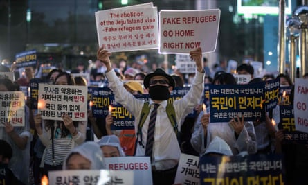Anti-immigration activists protest against asylum-seekers from Yemen, in Seoul.