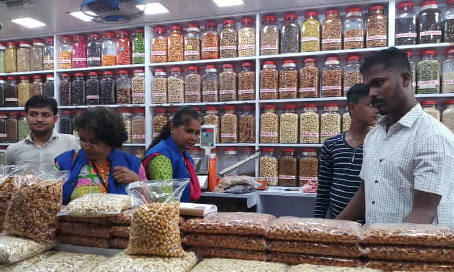 Mumbai blue squad searches a shop for plastic bags.