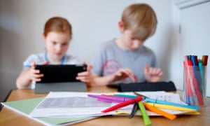 children on computer and tablet