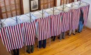 Voters cast their ballots at the Sutton town hall in the US presidential election
