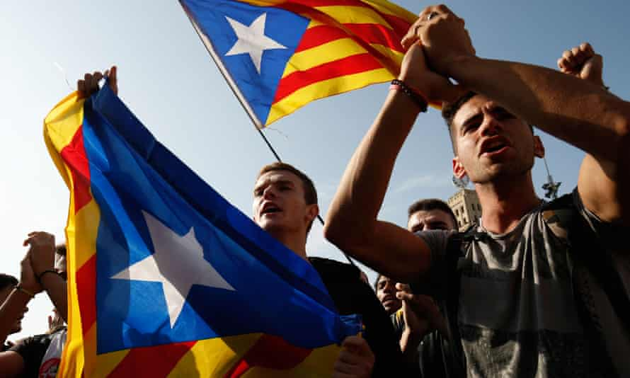 Pro-independence protesters hold Catalan flags in Barcelona
