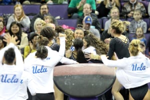 UCLA gymnast Kyla Ross celebrates with teammates after scoring a perfect 10 on the vault during a meet between the UCLA Bruins and the Washington Huskies in February 2019.