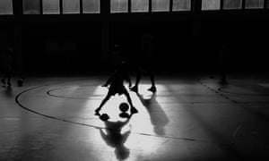 Children playing football indoors