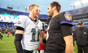 Carson Wentz (left) talks to Baltimore Ravens quarterback Joe Flacco after a game earlier this month