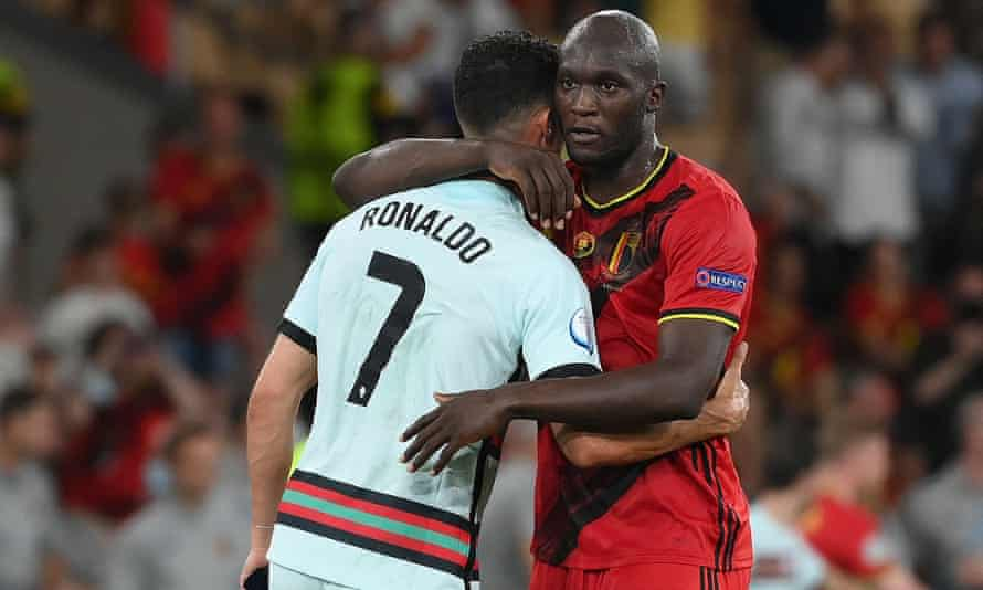 Cristiano Ronaldo and Romelu Lukaku embrace after the final whistle in Seville.