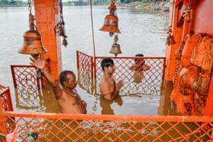 Jabalpur, IndiaHindu devotees worship a statue of Lord Hanuman in a flooded temple as water levels of Narmada river rise in Jabalpur, Madhya Pradesh on September 23, 2019. (Photo by Uma Shankar MISHRA / AFP)UMA SHANKAR MISHRA/AFP/Getty Images