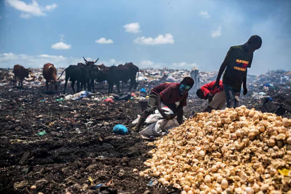 Children sort through the waste in a dump in Senegal.