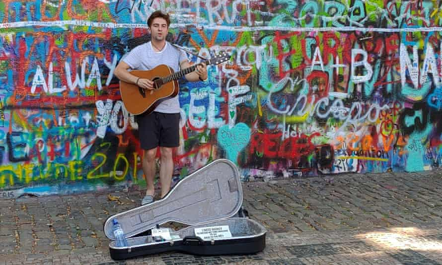 A busker at the Lennon wall, one of Prague's leading cultural attractions.