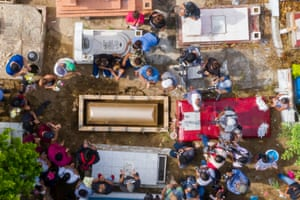 Relatives and friends attend the funeral of Erick Hernandez, DJ at the Caballo Blanco bar at a cemetery in Coatzacoalcos, Veracruz State, Mexico