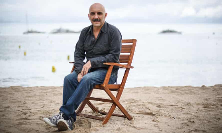 Like a villain from Tintin … Gaspar Noé on the beach at Cannes.