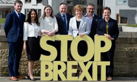 Nicola Sturgeon poses with the SNP's six candidates and a 'Stop Brexit' sign