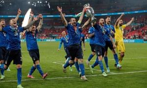 Giorgio Chiellino and Leonardo Bonucci celebrates with the trophy in front of the Italian fans.