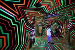 Taipei, TaiwanPeople take souvenir photos inside the installation 'Fading colors and Glow' by the Berlin base art group 'Tape That' during an art exhibition