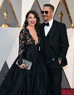 Charlotte Riley and Tom Harding. All kinds of wrong here: Riley's dress is very Dita Von Teese circa 2006 and Hardy's goatee and sunglasses make him look as if he's checking in on a budget airline en route to his mate's stag do.