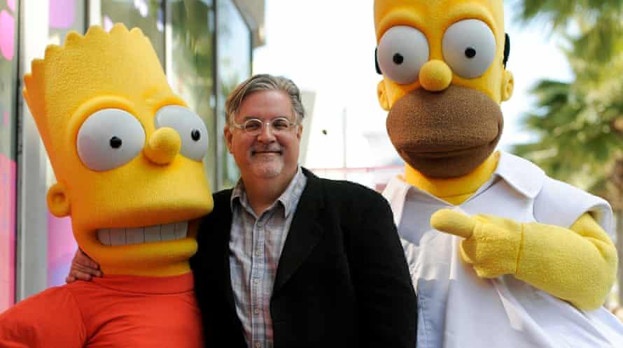 Matt Groening with Bart and Homer Simpson