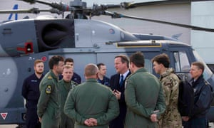 Britain's prime minister David Cameron chats with Royal Navy personnel