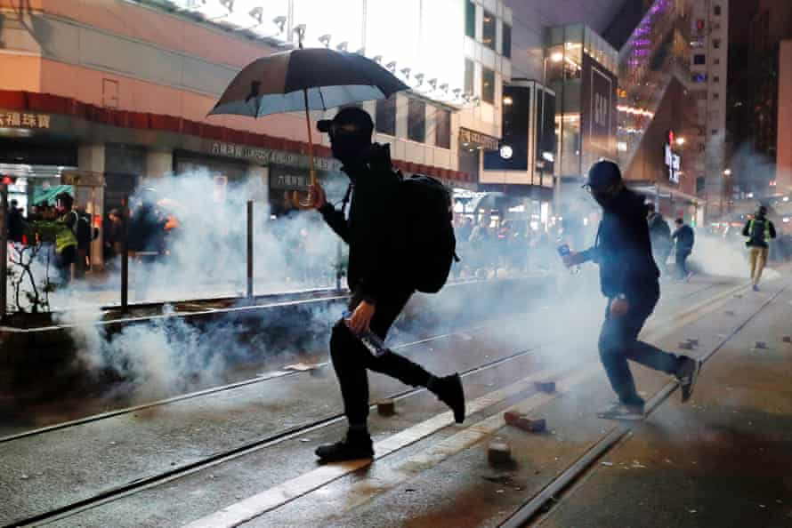 Protesters try to dodge teargas.