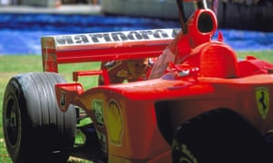 Michael Schumacher surveys the damage to his car – complete with Marlboro advertising – at the Australian grand prix in 2001.