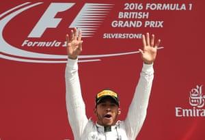 Lewis Hamilton celebrates on the podium after winning the British Grand Prix.