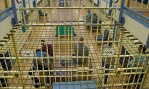 Prisoners on a landing in a prison.
