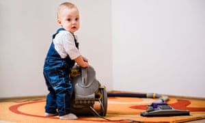Baby with a vacuum cleaner