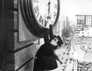 Show-stopping … Harold Lloyd hangs from a clock face in Safety Last! (1923).