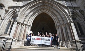 Protesters celebrate after the court of appeal declared UK arms sales to Saudi Arabia unlawful.