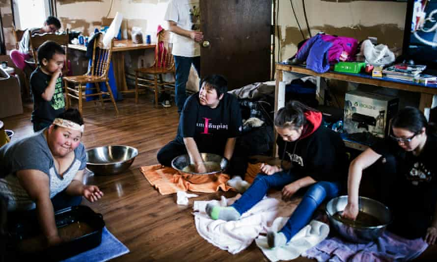 Women make akutaq or 'eskimo ice cream' with seal oil and caribou fat in Clark Lane's home.