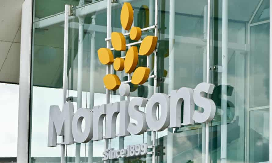 A Morrisons sign on the outside of a supermarket