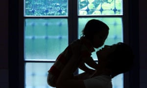 Silhouette of  mother holding her daughter