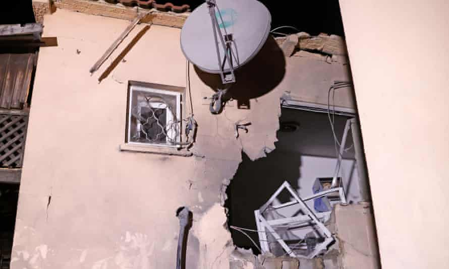 A house in the Israeli city of Sderot that was damaged by a rocket fired from Gaza by Hamas, 19 May.
