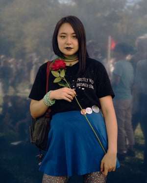 """Kaity Jia, 21, poses for a portrait at the Climate Strike NYC protest, part of a worldwide day of protests to bring attention to climate change. What scares you most about climate change? """"We are in a nightmare scenario right now. If we don't act fast, there will be a lot of chaos and people suffering. I don't want us to have to fight for our lives."""" Why are you marching? """"This is something that I've supported my whole life: preserving the environment. A lot of young people who share this sentiment are now the ones who will be seeing the effects of climate change. We are young. We will have to live through this. We will have to live through natural disasters and rising sea levels. It's already happened in Puerto Rico and the Bahamas. Scientists have predicted this and there will be storms coming."""""""