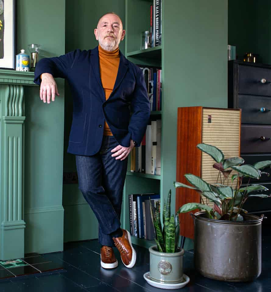 Style counsel: Adrian Clark wears a Mr Porter navy blazer and jeans, John Smedley rollneck, and Grenson leather trainers.