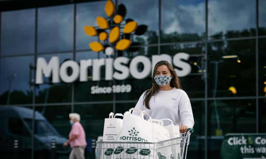 Woman pushing a trolley outside a Morrisons store
