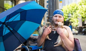 Richard Dyer with his pet ferrets Ricky and Tiny in Seattle, Washington