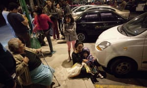 People wait on a street in Mexico City after the earthquake