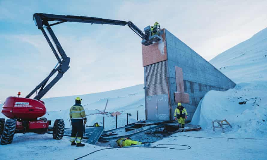Construction workers add the finishing touches to the seed vault.