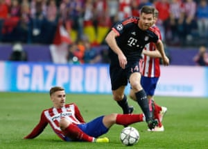 Alonso rides a challenge from Antoine Griezmann during Bayern Munich's Champions League semi-final tie with Atlético Madrid last season.