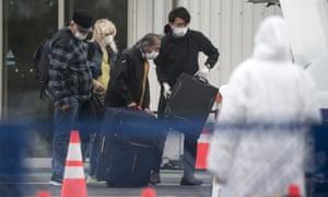 Passengers disembark from the quarantined Diamond Princess cruise ship.