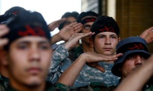 Iraqi Shia fighters in Damascus swell the ranks of shia foreign fighters backing President Assad but numbers of Iranian combatants remain small.