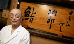 Jiro Ono pictured in front of his restaurant in 2007. Now in his 90s, he still makes its famed sushi with the help of his eldest son.