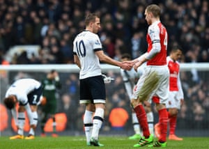 Harry Kane of Tottenham Hotspur and Per Mertesacker of Arsenal shake hands after the final whistle.