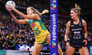 Australia's goal shooter, Caitlin Bassett, catches the ball under the post during the 2015 Netball World Cup match against New Zealand at Allphones Arena in Sydney.