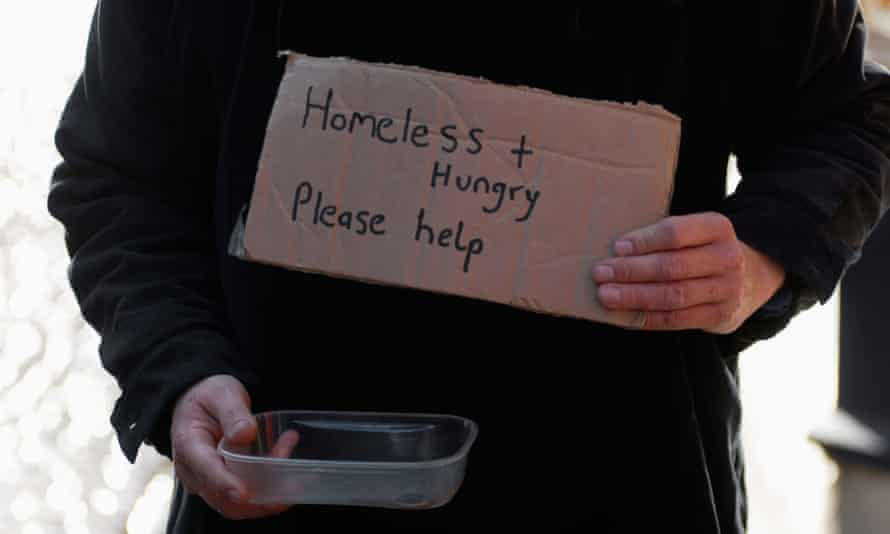 A homeless person begging on the street Coventry UK