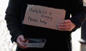 A homeless person begging on the street