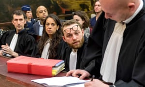 Lawyers representing Sofiane Ayari and Salah Abdeslam wait prior to the opening of the trial on Monday morning.